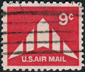 Postage stamp printed in the USA, shows Silhouette of Delta Wing Plane — Stock Photo