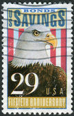 Postage stamp printed in the USA, dedicated to the 50th Anniversary Savings Bonds, shows a Bald Eagle (Haliaeetus leucocephalus) — Stock Photo