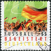 Postage stamp printed by Germany, dedicated to the 2012 UEFA European Championship, shows German football fans — Stock Photo