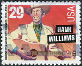 Postage stamp printed in the USA, shows an American singer-songwriter and musician Hank Williams — Stock Photo