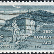 Stock Photo: Postage stamp printed in USA, Homestead Act Centenary, shows Sod Hut and Settlers