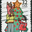 Postage stamps printed in USA, Christmas Issue, shown Decorating Tree — Stock Photo