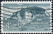 Postage stamp printed in the USA, Homestead Act Centenary, shows Sod Hut and Settlers — Stock Photo