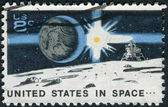 A postage stamp printed in USA, Space Achievement Decade Issue, shows the Earth, Sun, Landing Craft on Moon — Stock Photo