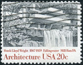 A postage stamp printed in USA, shows Fallingwater, Mill Run, Pennsylvania, by Frank Lloyd Wright — Stock Photo