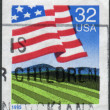 Postage stamp printed in USA, shows Flag Over Field — Stock Photo