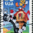 Postage stamp printed in USA, shows cartoon characters Sylvester and Tweety — Stock Photo #37859339
