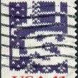 Stock Photo: Postage stamp printed in USA, Christmas Issue, shows knitted snowman
