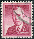 Postage stamp printed in USA, shows a portrait of 28th President of the United States, Thomas Woodrow Wilson by Frank Graham Cootes — Stock Photo