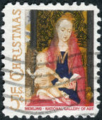 "Postage stamp printed in USA, Christmas Issue, shows a picture of the National Gallery of Art, ""Madonna and Child with Angels"" by the Flemish artist Hans Memling, — Foto Stock"