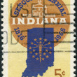 Postage stamp printed in USA, is dedicated to Indiana Statehood Sesquicentennial, shows Sesquicentennial Seal, Map of Indiana with 19 Stars and Old Capitol at Corydon — Stock Photo #37860087