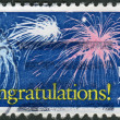 "Stock Photo: Postage stamp printed in USA, Special Occasions, shows fireworks in sky and text ""Congratulations!"""