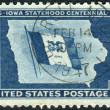 Stock Photo: Postage stamp printed in USA, dedicated to IowStatehood Centenary, shows IowState Flag and Map