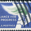 Stock Photo: Postage stamp printed in USA, is dedicated to 2nd anniv. of Alliance for Progress, which aims to stimulate economic growth & raise living standards in Latin America, shows Alliance Emblem