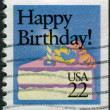 "Stock Photo: Postage stamp printed in USA, Special Occasions, shows piece of cake with candle and text ""Happy Birthday!"""