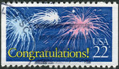 "Postage stamp printed in USA, Special Occasions, shows fireworks in the sky and the text ""Congratulations!"" — Stock Photo"