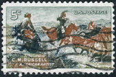 "Postage stamp printed in USA, shows a picture of ""Jerked Down"" by Charles M. Russell — Stock Photo"
