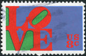 """Postage stamp printed in USA, shows the word """"Love,"""" by Robert Indiana — Photo"""