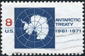 Postage stamp printed in USA, dedicated to the 10th anniv. of the Antarctic Treaty pledging peaceful uses of and scientific cooperation in Antarctica, shows Map of Antarctica — Stock Photo
