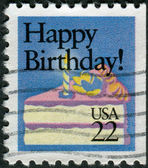 "Postage stamp printed in USA, Special Occasions, shows a piece of cake with a candle and the text ""Happy Birthday!"" — Stock Photo"