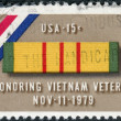 Stock Photo: Postage stamp printed in USA, is dedicated to tribute to veterans of Viet Nam War, shows Ribbon for Viet Nam Service Medal