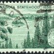 Stock Photo: Postage stamp printed in USA, dedicated to MinnesotStatehood Centenary, shows MinnesotLakes and Pines