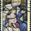 "Stock Photo: Postage stamp printed in USA, Christmas Issue, depicts ""Madonnand Child"", stained glass window Washington National Cathedral"