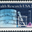 Postage stamp printed in USA, is dedicated to Health Research, shows Lab Equipment — Stock Photo