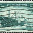 Postage stamp printed in USA, dedicated to Achievements of U.S. Merchant Marine in WWII, shows Liberty Ship Unloading Cargo — Stock Photo #37919877