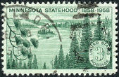 Postage stamp printed in USA, dedicated to the Minnesota Statehood Centenary, shows Minnesota Lakes and Pines — Stock Photo