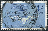 Postage stamp printed in USA, dedicated to the 50th Anniversary Naval Aviation, shows Navy's First Plane (Curtiss A-1 of 1911) and Naval Air Wings — Stock Photo