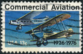 Postage stamp printed in USA, dedicated to the 50th Anniversary of 1st contract airmail flights, shows Ford-Pullman Monoplane and Laird Swallow Biplane — Stock Photo