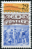 Postage stamp printed in USA, are devoted to World Columbian Stamp Expo, shows the landing of Christopher Columbus (fragment of a postage stamp in 1869) — Stock Photo