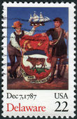 Postage stamp printed in USA, dedicated to the 200th anniversary the ratification of the U.S. Constitution, the State of Delaware, depicts two men with the emblem of the State of Delaware — Stock Photo