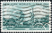 "Postage stamp printed in USA, dedicated to the New York World's Fair (1964-65), shows Mall with Unisphere & ""Rocket Thrower,"" by Donald De Lue — Stock Photo"