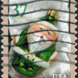 Stock Photo: Postage stamp printed in USA, Christmas Issue, shows Green SantOrnament
