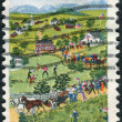"A postage stamp printed in USA, shows a picture of the ""July Fourth"" by Grandma Moses (Anna Mary Robertson Moses), primitive painter of American life — Stock Photo #38054413"
