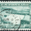 Postage stamp printed in the USA, dedicated to the 50th anniversary of federal cooperation in developing the resources of rivers and streams in the West, shows the Spillway, Grand Coulee Dam — Stock Photo #38054595