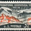 "A postage stamp printed in the USA, dedicated Geophysical Year (IGY, 1957-58), shows Solar Disc and Hands from Michelangelo's ""Creation of Adam"" — Stock Photo #38054779"