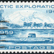 "Postage stamps printed in USA, Conquest of the Arctic by land by Rear Admiral Robert Edwin Peary in 1909 and by sea by the submarine ""Nautilus"" in 1958, shows the North Pole Dog Sled and ""Nautilus"" — Stock Photo #38054931"