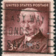 Постер, плакат: A postage stamp printed in USA shows George Eastman Inventor and Philanthropist