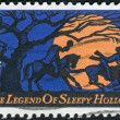 A postage stamp printed in USA, Legend of Sleepy Hollow, by Washington Irving. Design features Headless Horseman pursuing Ichabod Crane — Stock Photo #38056091