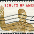 Постер, плакат: A postage stamp printed in the USA dedicated to the 50th Anniversary Boy Scouts of America shows Boy Scout Giving Scout Sign