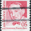 Stock Photo: Postage stamps printed in USA, shows portrait 1st Governor of Commonwealth of Puerto Rico, Luis Munoz Marin