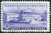 A postage stamp printed in the USA, dedicated to the 150th anniversary of the establishment of the National Capital, Washington, DC, shows the Supreme Court Building — Stock Photo