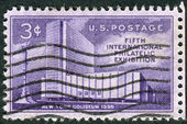 Postage stamp printed in the USA, dedicated to the International Philatelic Exhibition, FIPEX, New York City, shows the New York Coliseum and Columbus Monument — 图库照片