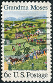 "A postage stamp printed in USA, shows a picture of the ""July Fourth"" by Grandma Moses (Anna Mary Robertson Moses), primitive painter of American life — Stock Photo"