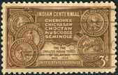 A postage stamp printed in the USA, dedicated to the Centenary of the arrival in Indian Territory, Oklahoma, of the Five Civilized Indian Tribes, shows Map of Indian Territory and Seals of Five Tribes — Stock Photo