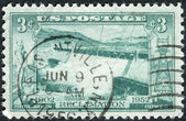 Postage stamp printed in the USA, dedicated to the 50th anniversary of federal cooperation in developing the resources of rivers and streams in the West, shows the Spillway, Grand Coulee Dam — Stock Photo