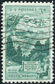 Postage stamp printed in the USA, dedicated to the 25th anniversary of the dedication of the Mount Rushmore National Memorial, shown Sculptured Heads on Mount Rushmore — Stock Photo